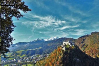 Burg Hohenwerfen and snow capped mountains around.